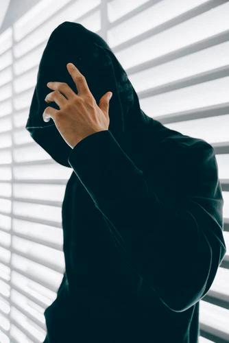Hacker wearing hoodie