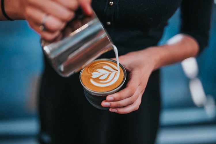 Barista-creating-latte-art