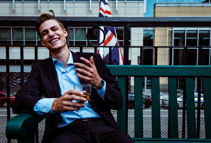 Man-laughing-with-British-flag-in-background