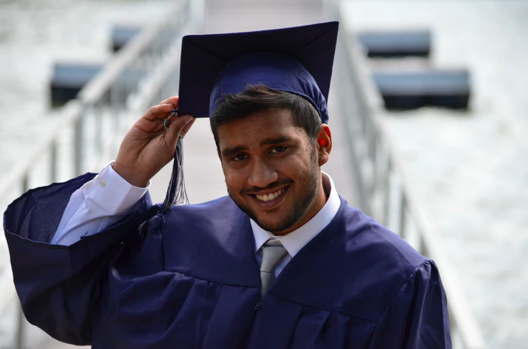 smiling-man-in-graduation-robes