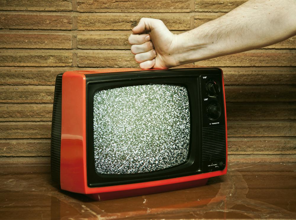 fist hitting tv