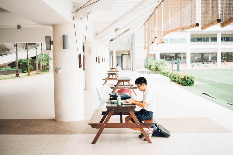 student sitting alone at table