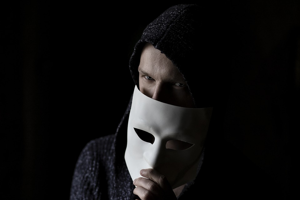 man with mask and hoodie