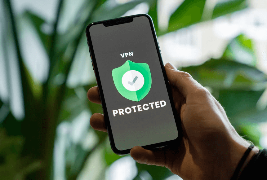 hand holding iphone with vpn logo