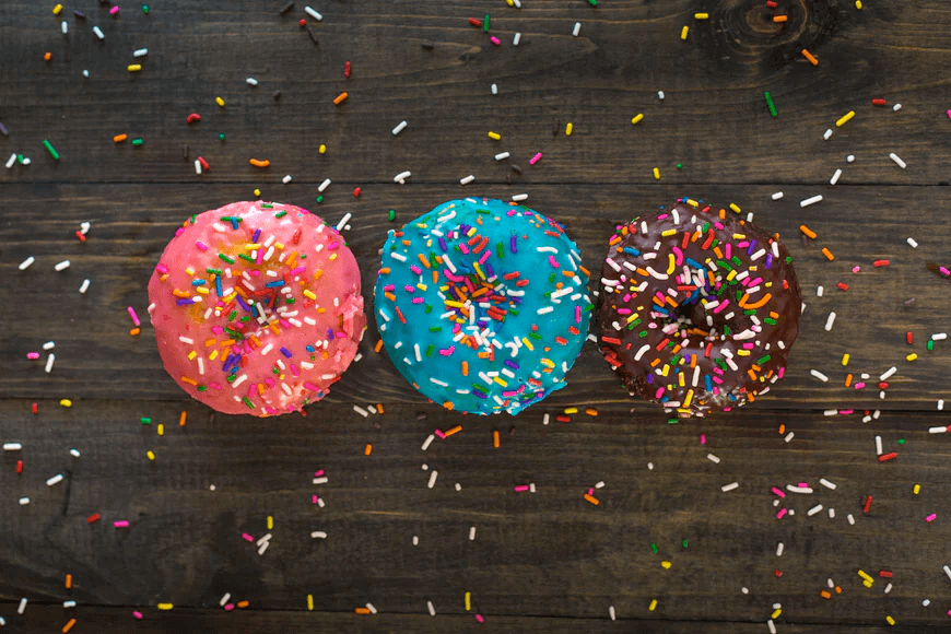 three donuts on wooden table